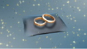 Royalty Free HD Video Clip of Rotating Wedding Rings on a Pillow