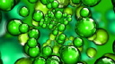 Royalty Free HD Video Clip of Rotating Green Bubbles