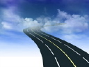Royalty Free Video of a Four-Lane Highway Through the Clouds