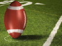 Royalty Free Video of Football Players and a Giant Football