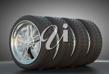 Group of four automotive wheels with studio light background
