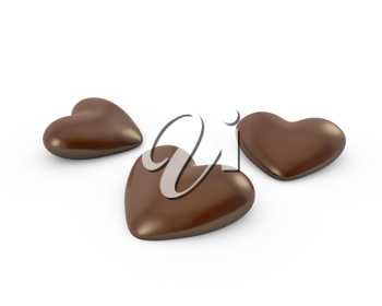 Thre heart shaped chocolate candies, isolated on white background