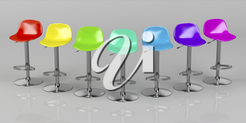 Unique colorful bar stools on shiny gray background, front view