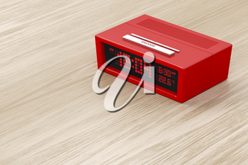 Red alarm clock on wood background