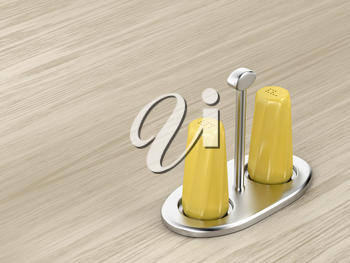 Yellow salt and pepper shakers on the wood table