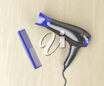 Black hair dryer and purple comb on wood table, top view