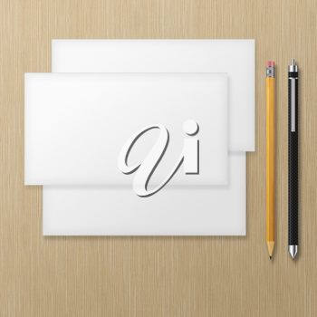 Set of blank envelopes with yellow pencil and pen on wooden background. With soft shadows.