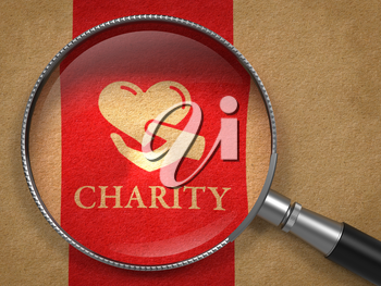 Charity Concept: Magnifying Glass with Icon of Heart in the Hand and Word Charity on Old Paper with Red Vertical Line Background.