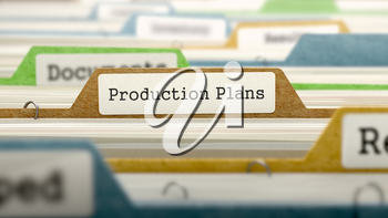Production Plans on Business Folder in Multicolor Card Index. Closeup View. Blurred Image. 3d Render.