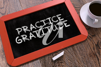 Practice Gratitude Handwritten on Red Chalkboard. Business Concept. Composition with Chalkboard and Cup of Coffee. Top View Image. 3d Render.