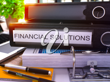 Black Office Folder with Inscription Financial Solutions on Office Desktop with Office Supplies and Modern Laptop. Financial Solutions Business Concept on Blurred Background. 3D Render.