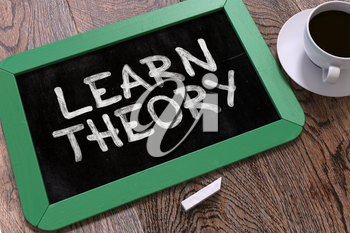 Learn Theory Concept Hand Drawn on Green Chalkboard on Wooden Table. Business Background. Top View. 3D Render.