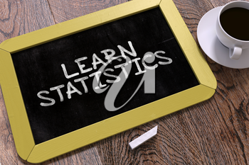 Hand Drawn Learn Statistics Concept  on Small Yellow Chalkboard. Business Background. Top View. 3D Render.