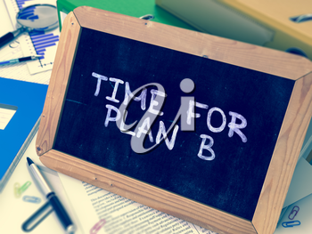 Time for Plan B Handwritten on Chalkboard. Composition with Small Chalkboard on Background of Working Table with Ring Binders, Office Supplies, Reports. Blurred Background. Toned Image. 3D Render.