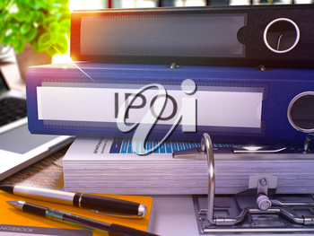 Blue Office Folder with Inscription IPO - Initial Public Offering - on Office Desktop with Office Supplies and Modern Laptop. IPO Business Concept on Blurred Background. IPO - Toned Image. 3D Render.