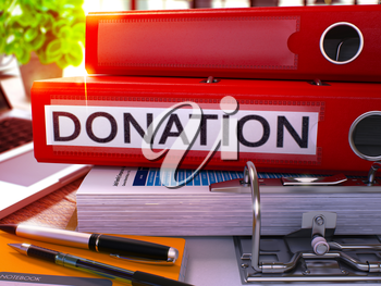 Donation - Red Office Folder on Background of Working Table with Stationery and Laptop. Donation Business Concept on Blurred Background. Donation Toned Image. 3D Render.