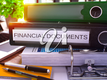 Black Ring Binder with Inscription Financial Documents on Background of Working Table with Office Supplies and Laptop. Financial Documents Business Concept on Blurred Background. 3D Render.