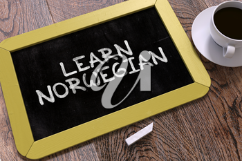 Learn Norwegian Concept Hand Drawn on Yellow Chalkboard on Wooden Table. Business Background. Top View. 3D Render.