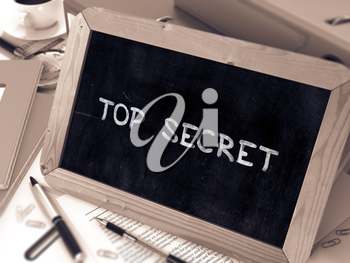Top Secret Concept Hand Drawn on Chalkboard on Working Table Background. Blurred Background. Toned Image. 3D Render.