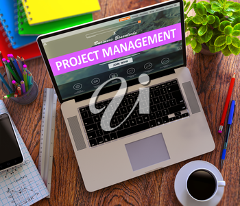 Project Management Concept. Modern Laptop and Different Office Supply on Wooden Desktop background. 3D Render.
