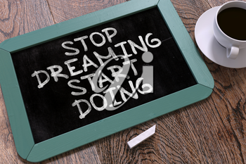 Handwritten Stop Dreaming Start Doing on a Blue Chalkboard. Top View Composition with Chalkboard and White Cup of Coffee. 3D Render.
