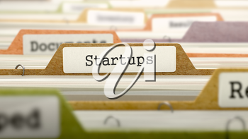 File Folder Labeled as Startups in Multicolor Archive. Closeup View. Blurred Image. 3D Render.