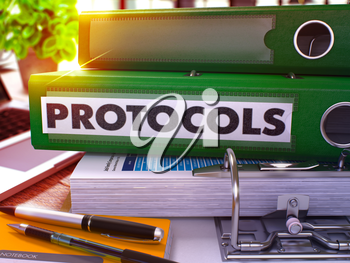 Protocols - Green Office Folder on Background of Working Table with Stationery and Laptop. Protocols Business Concept on Blurred Background. Protocols Toned Image. 3D.