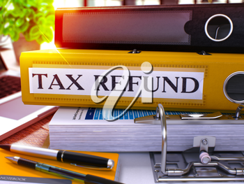 Tax Refund - Yellow Office Folder on Background of Working Table with Stationery and Laptop. Tax Refund Business Concept on Blurred Background. Tax Refund Toned Image. 3D.