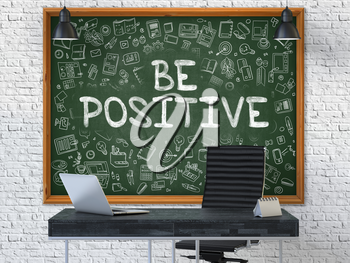 Be Positive Concept Handwritten on Green Chalkboard with Doodle Icons. Office Interior with Modern Workplace. White Brick Wall Background. 3D.