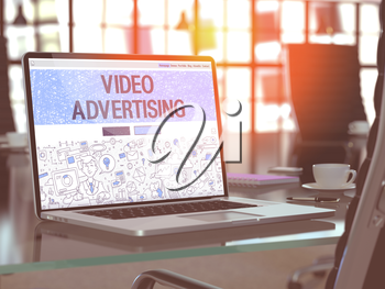 Modern Workplace with Laptop Showing Landing Page in Doodle Design Style with Text Video Advertising. Toned Image with Selective Focus. 3D Render.