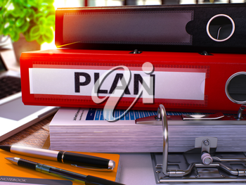 Plan - Red Office Folder on Background of Working Table with Stationery and Laptop. Plan Business Concept on Blurred Background. Plan Toned Image. 3D.