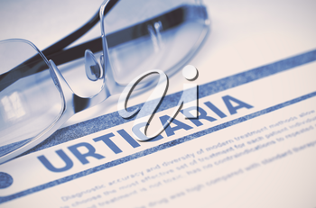 Urticaria - Medicine Concept on Blue Background with Blurred Text and Composition of Eyeglasses. 3D Rendering.