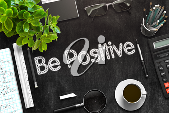 Be Positive. Business Concept Handwritten on Black Chalkboard. Top View Composition with Chalkboard and Office Supplies. 3d Rendering. Toned Image.