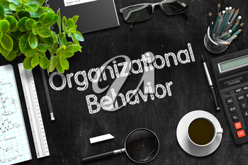 Organizational Behavior. Business Concept Handwritten on Black Chalkboard. Top View Composition with Chalkboard and Office Supplies. 3d Rendering.