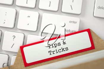 Tips and Tricks Concept. Word on Red Folder Register of Card Index. Closeup View. Selective Focus. 3D Rendering.