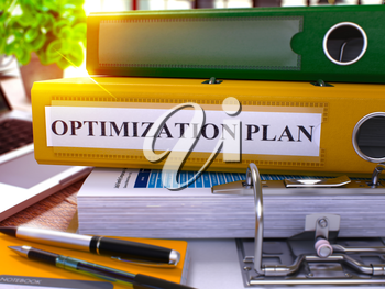 Optimization Plan - Yellow Office Folder on Background of Working Table with Stationery and Laptop. Optimization Plan Business Concept on Blurred Background. Optimization Plan Toned Image. 3D.