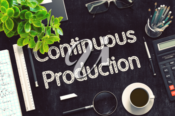Continuous Production. Business Concept Handwritten on Black Chalkboard. Top View Composition with Chalkboard and Office Supplies. 3d Rendering. Toned Illustration.
