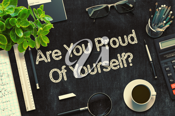 Are You Proud Of Yourself - Black Chalkboard with Hand Drawn Text and Stationery. Top View. 3d Rendering. Toned Image.