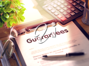 Guarantees- Text on Clipboard with Office Supplies on Desk. 3d Rendering. Toned and Blurred Illustration.