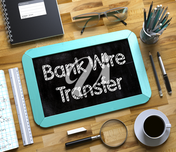 Bank Wire Transfer Concept on Small Chalkboard. Top View of Office Desk with Stationery and Mint Small Chalkboard with Business Concept - Bank Wire Transfer. 3d Rendering.