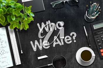 Who We Are. Business Concept Handwritten on Black Chalkboard. Top View Composition with Chalkboard and Office Supplies. 3d Rendering. Toned Image.