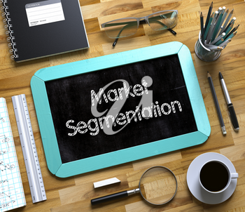 Market Segmentation Concept on Small Chalkboard. Top View of Office Desk with Stationery and Mint Small Chalkboard with Business Concept - Market Segmentation. 3d Rendering.