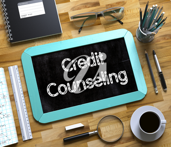 Credit Counseling - Text on Small Chalkboard.Top View of Office Desk with Stationery and Mint Small Chalkboard with Business Concept - Credit Counseling. 3d Rendering.