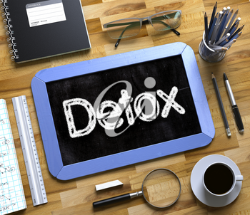 Detox - Text on Small Chalkboard.Blue Small Chalkboard with Handwritten Business Concept - Detox - on Office Desk and Other Office Supplies Around. Top View. 3d Rendering.