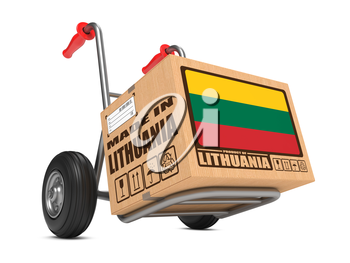 Cardboard Box with Flag of Lithuania and Made in Lithuania Slogan on Hand Truck White Background. Free Shipping Concept.