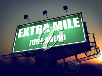 Extra Mile Just Ahead - Green Billboard on the Rising Sun Background.