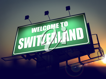 Welcome to Switzerland - Green Billboard on the Rising Sun Background.