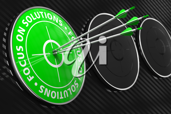 Focus on the Solutions Slogan. Three Arrows Hitting the Center of Green Target on Black Background.