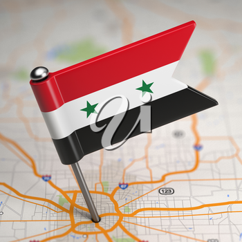 Small Flag of Syrian Arab Republic on a Map Background with Selective Focus.