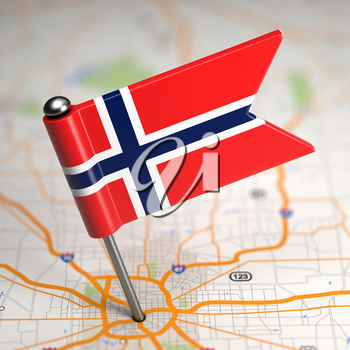 Small Flag of Norway Sticked in the Map Background with Selective Focus.